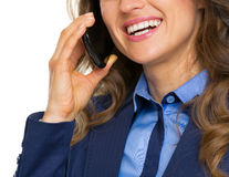 Closeup on happy business woman talking mobile phone Stock Images