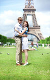 Closeup of happy couple hugging near the Eiffel tower Stock Image