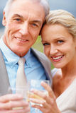 Closeup of a happy couple toasting drinks outdoors Royalty Free Stock Photography
