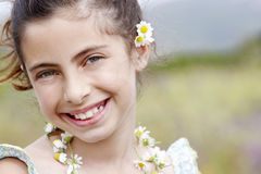Closeup Of Happy Cute Little Girl In Flower Necklace Stock Image