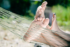 Closeup of happy family lying on hammock on sunny countryside background. Royalty Free Stock Image