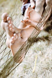 Closeup of happy father and child barefoot feet in Royalty Free Stock Images