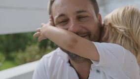 Closeup happy father and little son are hugging and laughing. Warm relationship between dad and son. Closeup happy brutal father and little charming son hug and stock footage