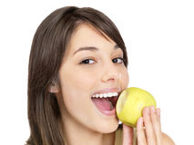 Closeup of a happy female eating a green apple Stock Images