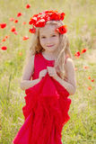 Closeup of happy  girl in poppy field Stock Photography