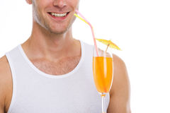Closeup on happy guy holding cocktail Stock Photos