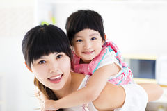 Closeup of happy little girl and mother stock photos