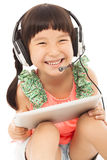 Closeup of happy little student girl holding a tablet Royalty Free Stock Photos