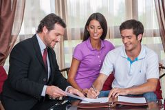 Closeup on happy man signing agreement on new house. Royalty Free Stock Photo