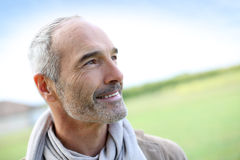 Closeup of happy man standing in countryside Royalty Free Stock Photos
