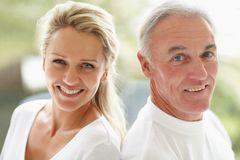 Closeup of a happy mature couple back to back Stock Photo