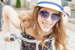Closeup happy pretty woman travel to Paris by city bicycle Stock Photos