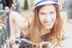 Closeup happy pretty woman travel to Paris by city bicycle Royalty Free Stock Photography
