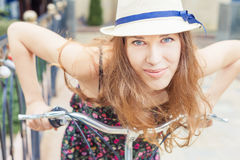 Closeup happy pretty woman travel to Paris by city bicycle Stock Image