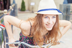 Closeup happy pretty woman travel to Paris by city bicycle Stock Photography