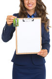 Closeup on happy realtor woman with keys showing blank clipboard Stock Image