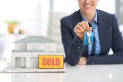 Closeup on happy realtor woman showing keys Stock Photos