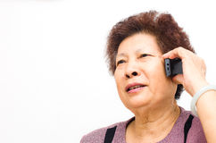 Closeup of a happy senior woman using cellphone Royalty Free Stock Photo