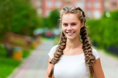 Closeup happy st 20- year-old woman in a white T-shirt with two stock images