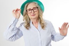 Closeup of happy stylish senior woman in business glasses and summer hat . Positive life living of elderly people. Healthy. Lifestyle and seniors fun time. Copy royalty free stock photography