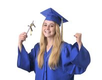 Closeup of happy teen girl graduate. Closeup of excited teen girl graduate with diploma Royalty Free Stock Image