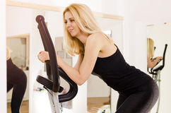 Closeup, happy woman on ellipse trainer Stock Image