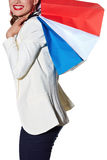 Closeup on happy woman with French flag colours shopping bags Stock Photography