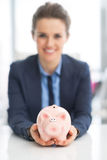 Closeup on happy woman holding piggy bank Royalty Free Stock Photos