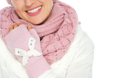 Closeup on happy woman in knit scarf and mittens Stock Photos