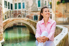 Closeup of happy woman smiling by canal in Venice Stock Photo