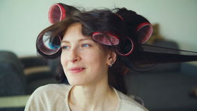 Closeup of happy women friends make fun curler hairstyle each other and have fun. At home stock video