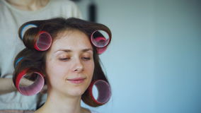 Closeup of happy women friends make fun curler hairstyle each other and have fun. At home stock video footage