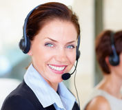 Closeup of a happy young call centre employee Stock Photo