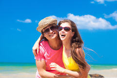 Closeup of happy young couple on beach smiling Stock Photography