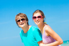 Closeup of happy young couple in sunglasses on Royalty Free Stock Photos
