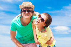 Closeup of happy young couple in sunglasses having. Fun on tropical beach. This image has attached release Royalty Free Stock Photography