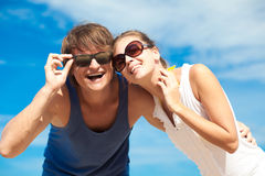 Closeup of happy young couple in sunglasses having Stock Photography