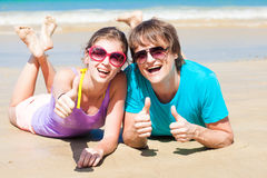 Closeup of happy young couple in sunglasses lying Royalty Free Stock Image