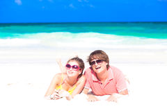 Closeup of happy young couple in sunglasses lying Stock Image