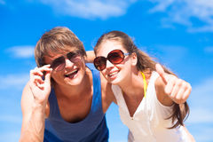 Closeup of happy young couple in sunglasses Royalty Free Stock Photos