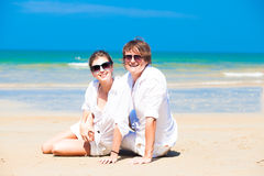 Closeup of happy young couple in white clothes in Stock Photo