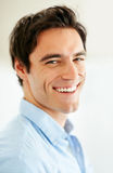 Closeup of a happy young man smiling Stock Photography