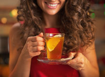Closeup on happy young woman with cup of ginger tea Stock Photography