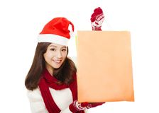 Closeup of happy young woman holding shopping bags. Christmas shopping concept Stock Photography