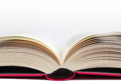 Closeup of a hardcover book open in the middle Stock Photos