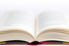 Closeup of a hardcover book open in the middle Stock Image