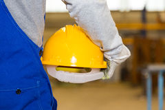 Closeup of a hardhat and construction laborer Stock Photos