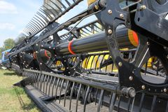 Closeup of harvesting machinery while working the Royalty Free Stock Images