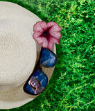 Closeup hat, flower and sunglasses Stock Images