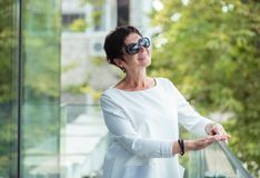 Mature woman looking upwards daydreaming royalty free stock images